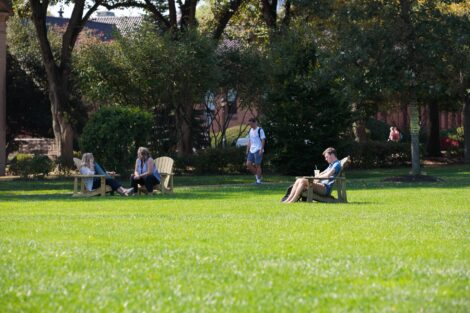 students sitting on the quad