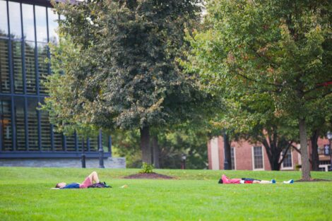 students lay on the quad