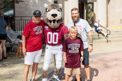 a family in Lafayette gear poses with the Leopard