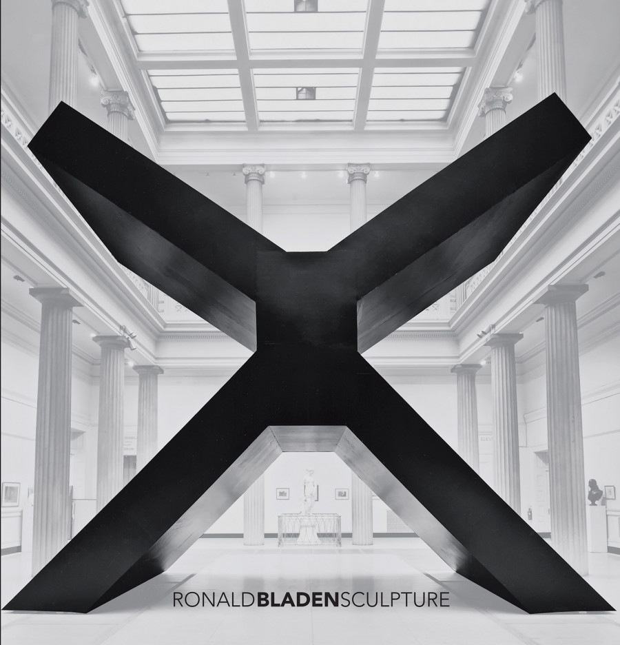 Large black X sculpture fills room in gallery
