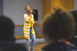 A student sings at the AfroCaribbean Showcase