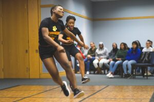 Two students dance at the AfroCaribbean Showcase
