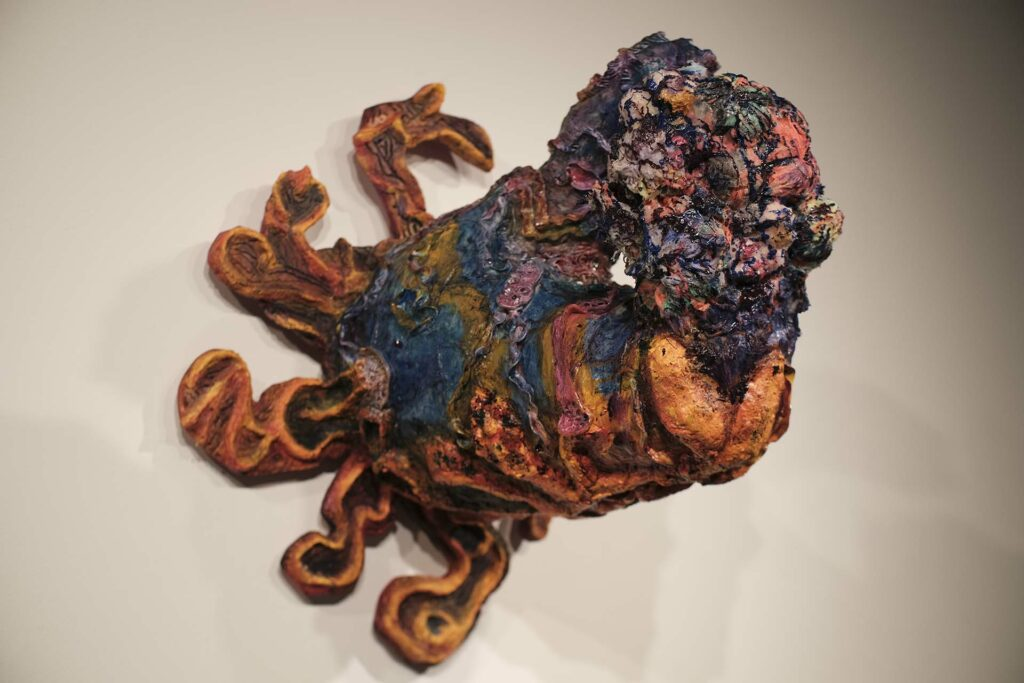 Painting and sculpture combine as piece rises off the wall like an octopus