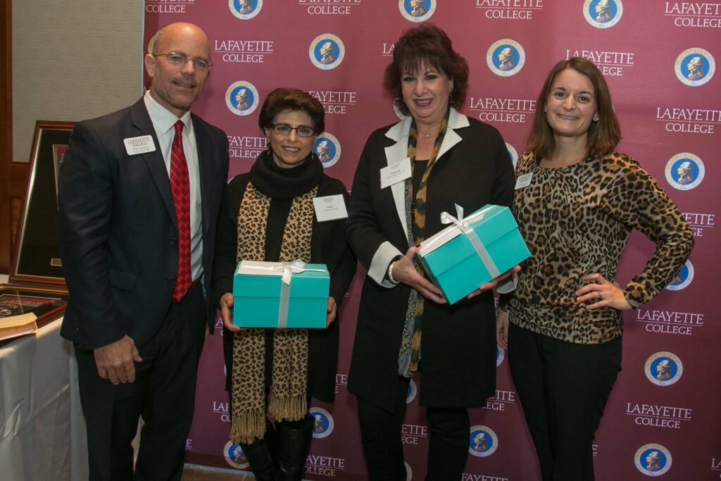 Laurie and Deborah hold a gift flanked by Mike and Melissa from Gateway Career Center