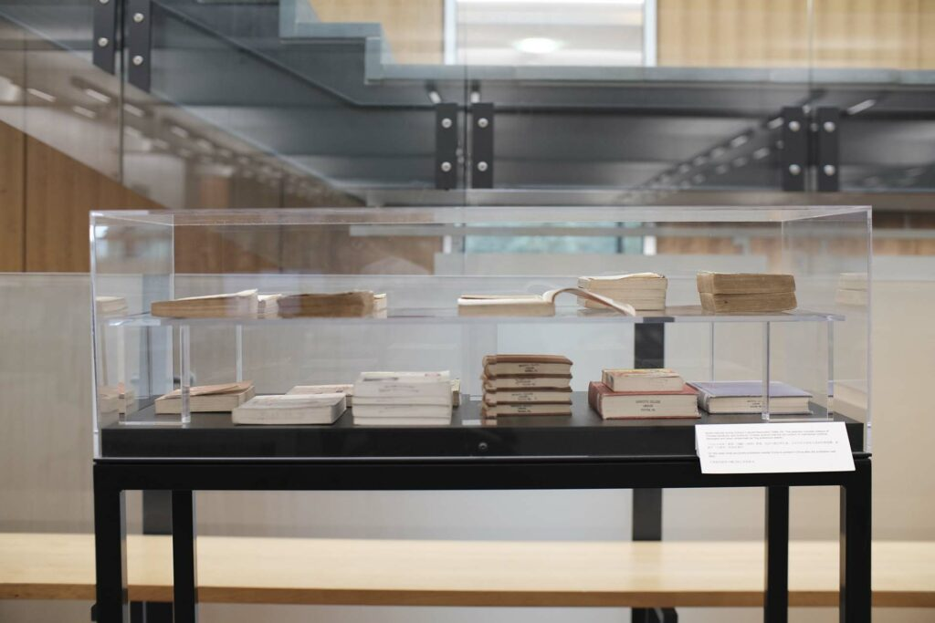 Xiaoze Xie's work on display in cases showing two levels of books