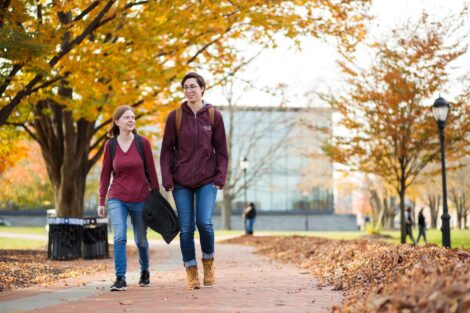 students set against the beautiful oranges and yellows of fall scenery at Lafayette
