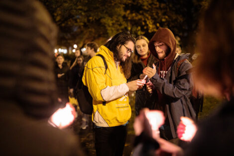 students light candles as part of the take back the night vigil