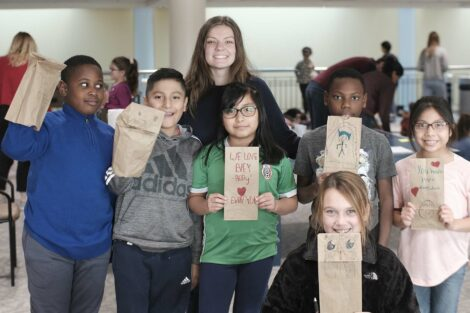 A group of fourth graders pose with their decorated bags