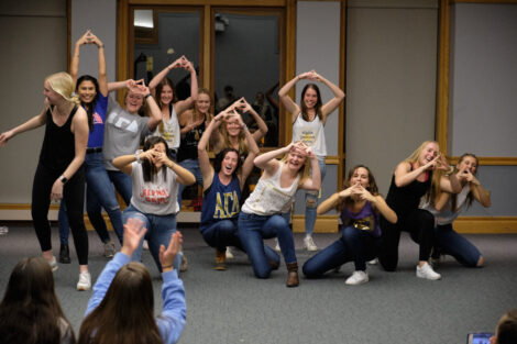 sororities dancing with each other in the marlo room