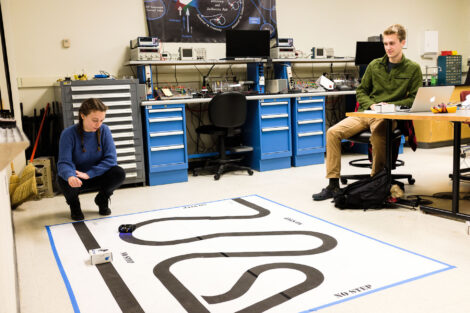 Connor Edson '20 and Hailey Crecca '20 tweak their line-following robots for their Controls project due Saturday. ''I like this class, so I want to put in the effort and work to make it good,'' says Hailey.