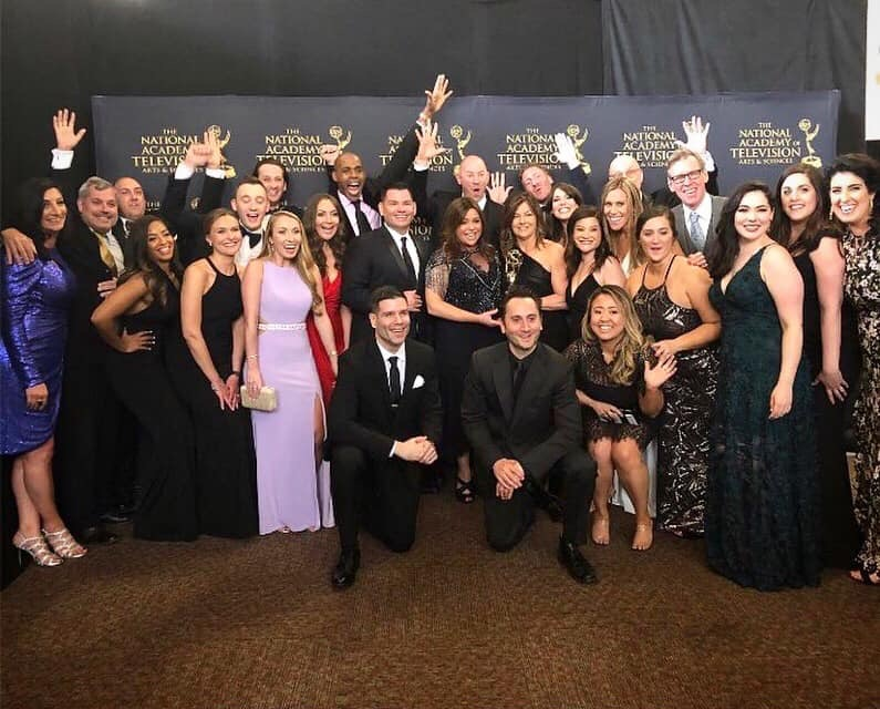 Jen Gsell '04 and her teammates on the Rachael Ray show pose for a group shot at the Emmy Awards