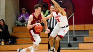 Lukas Jarrett dribbles the basketball against a Cornell defender.