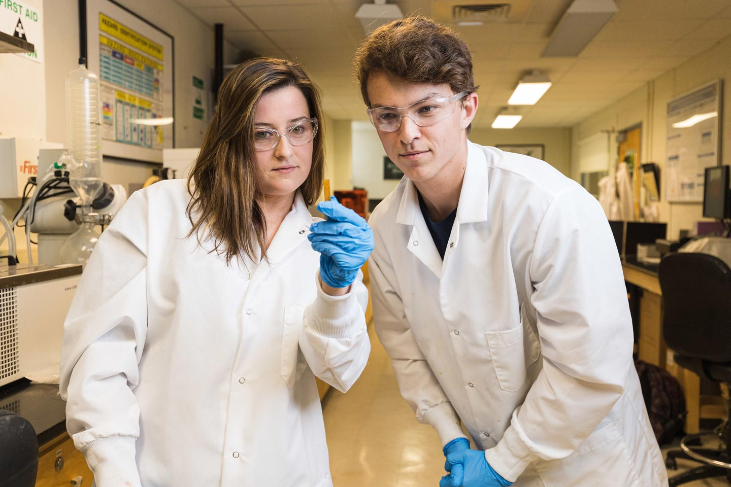 Prof. Melissa Gordon and Jimmy Hastie '22 (chemical engineering), an EXCEL Scholar working in her lab, inspect a piece of cured plant-based plastic.