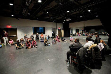 Members of Nobuntu begin singing and dancing workshop