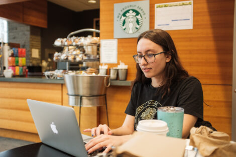 Tori Yordt '20 sits in Skillman Cafe waiting for her Pardner students to check in for their final projects.