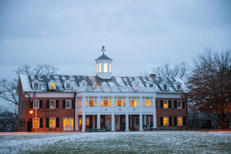 Snow dusts the campus at dusk