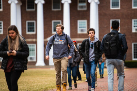 Students walk on campus on the first day of spring semester.