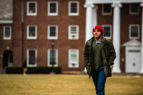 A student walks on campus on the first day of spring semester.
