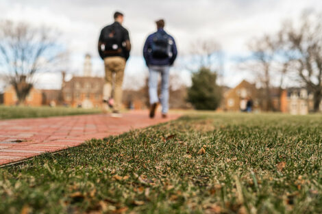 Two students walk on the Quad on the first day of spring semester.