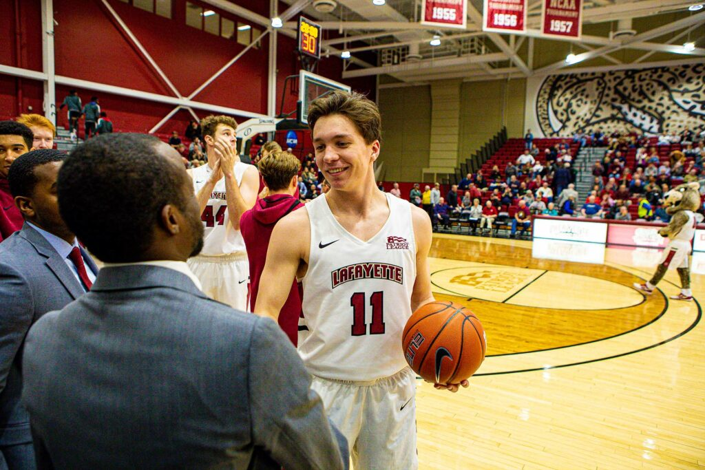 Justin Jaworski '21 is congratulated as he enters the 1,000-point club