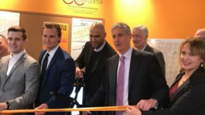 Yusuf Dahl and JB Reilly at a ribbon cutting ceremony for Allentown Real Estate lap