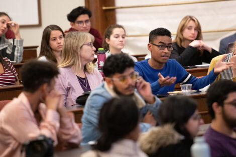 A student asks Stuart Delery a question during his talk on campus
