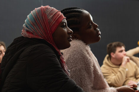Two students listening