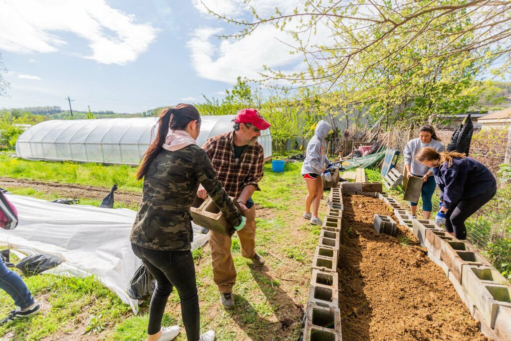 Landis Center student volunteers help at the Urban Garden