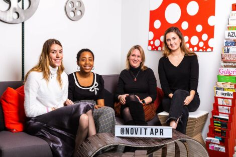 Lafayette alumni at Novita along with student extern sit on couch and smile