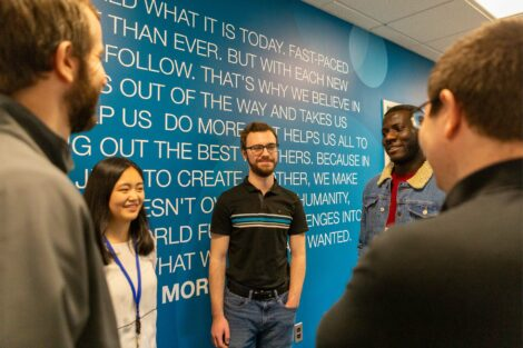 Externs gather at wall that names company's values