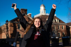 A student on the Quad showing her love for warm winter days.