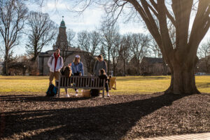 Students enjoying an unseasonably warm winter day on the quad, with Colton Chapel in the background.