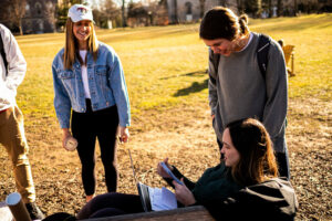 Students enjoying an unseasonably warm day on the Quad in Winter,.