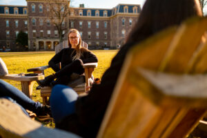 Lafayette College Sustainability Manager Kendall Roberson enjoying a warm Winter day on the Quad. In front of Pardee Hall.