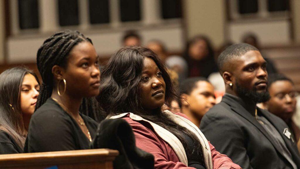 Students listen to Yusef Salaam speak in Colton Chapel
