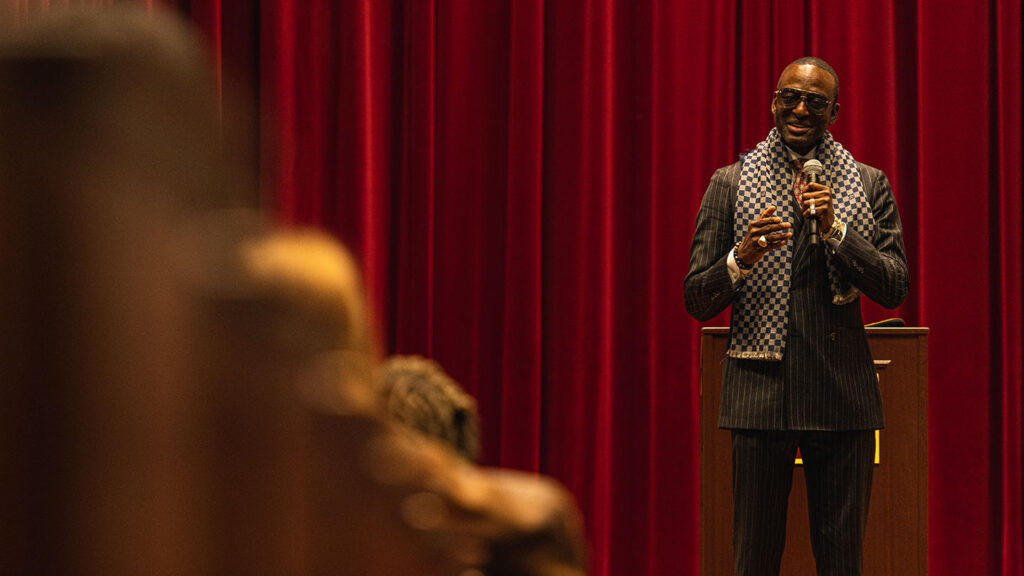 Yusef Salaam speaks to an audience in Colton Chapel