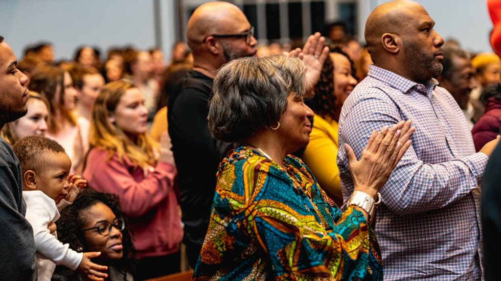 An audience in Colton Chapel gives Yusef Salaam a standing ovation.