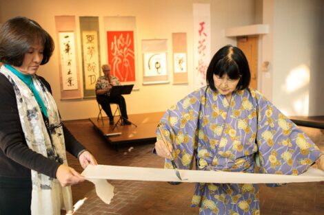 calligraphy master Shuho Kondo uses brush on paper