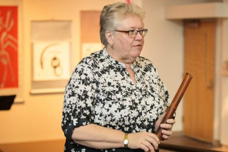Nora Nohraku Suggs holds the shakuhachi