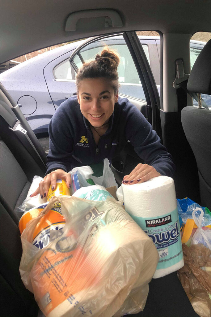 Kenzie Corbin with donation supplies