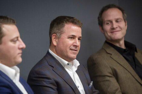 Three presenters speak to students