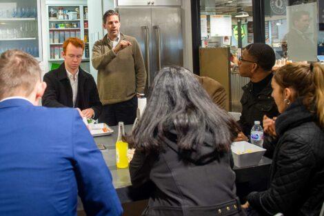 Students listen to speaker inside Easton Public Market