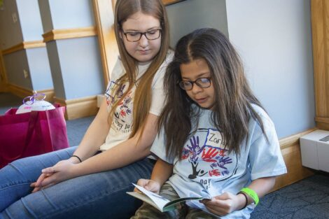 Lafayette student watches a child read