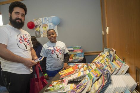 Child and Lafayette student shop for books