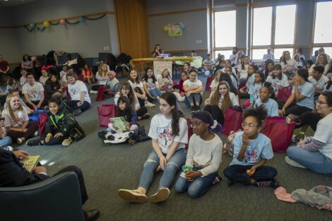 Students listen as the Mayor reads
