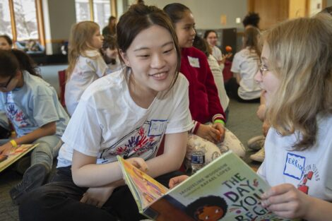 A Lafayette student reads a book with a young Easton student on Literacy Day.