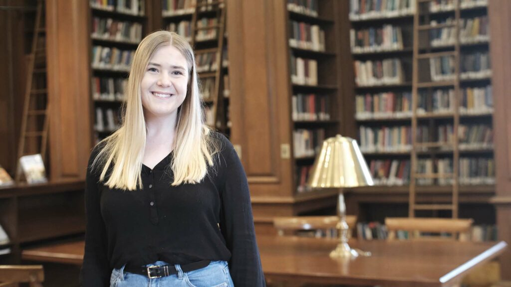 Victoria Zay '22 stands in the Kirby Library