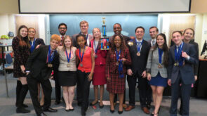 Members of the Forensics Society with trophy