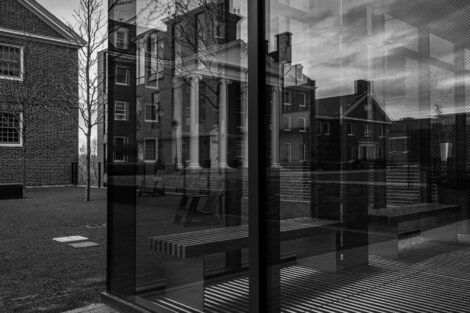 A reflection of Watson Hall from the glass clad main entryway of the Rockwell Integrated Science Center.