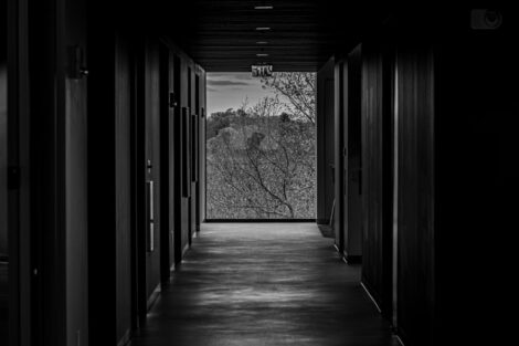 A long dark hallway with a view of Easton Pa.